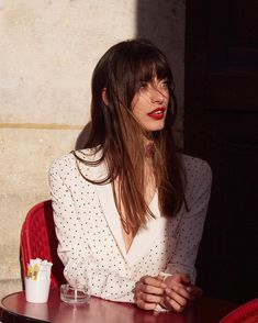 Polka dot white blouse top, red lips, bangs