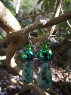 but me at https://www.etsy.com/listing/172845408/earth-element-dangles?ref=related-3