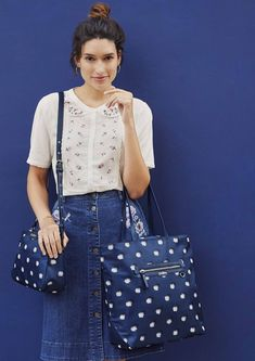 Navy blue spot bags with a sketched Pom Pom pattern. Handy bags to carry your daily essentials. Choose between a crossbody bag or a big tote (or both!)