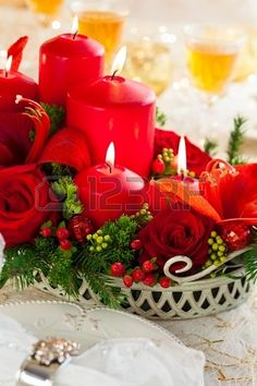 Christmas table decoration with flowers and candles Stock Photo - 15733134
