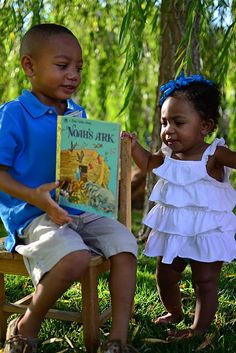 brother showing little sister a book, sweet moment