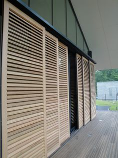 Persian sliding shutters in red cedar Volets coulissants persienn s en red cedar Shutters Exterior, House Design, Pool House, Outdoor Shutters, House Exterior, Sliding Shutters, Exterior Doors, Container House, Blinds