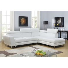 Add an instant upgrade to your living space with this sleek and contemporary white sectional. Complete with ratchet headrests, tufted seats and angled metal legs this sectional will be the centerpiece of any room in your home.