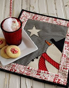 Happy Friday! It is day #7 of our 12 Days of Christmas. It seems like mini quilts are all the rage. But in fact, they aren't new. Well, at least not around here. My sister and I were looking th...