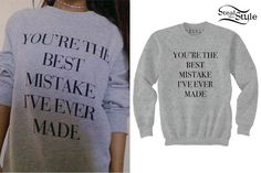 """set to start her Honeymoon Tour this Wednesday February 25th. She designed some tees and tops which will be sold in her merchandise booth at the concerts and she also made them available online today. She posted photos on her twitter and instagram wearing the clothes. Here she shows off the Ariana Grande Best Mistake Pullover Sweatshirt ($70.00) printed with the lyrics """"You're The Best Mistake I've Ever Made."""""""