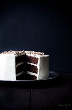 Chocolate Malt Layer Cake is dense, moist and totally decadent. Chopped malted milk balls add flavor and crunch. You need this dessert!
