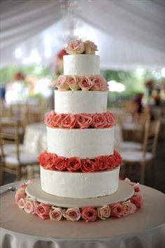 In <3 with this rose petal wedding cake! What a great pop of color!