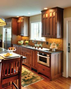 Love the backsplash.Craftsman Kitchen - Crown Point Cabinetry - Backsplash designed by Motawi Designer Hadley Lord - Arts & Crafts Homes and the Revival Rustic Kitchen Cabinets, Kitchen Redo, New Kitchen, Awesome Kitchen, Kitchen Ideas, Wood Cabinets, Beautiful Kitchen, Wooden Kitchen, Shaker Cabinets