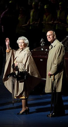 2012: Queen Elizabeth II (Elizabeth Alexandra Mary) (1926-living2013) UK & husband Prince Philip Duke of Edinburgh (Philip Mountbatten-born Prince Philip) (1921-living2013) Greece depart at Closing Ceremonies of the 10th anniversary of the of the XVII Commonwealth Games hosted in the Greater Manchester Region. They are the largest multi-sport event ever held in the UK. Photographer Unknown.
