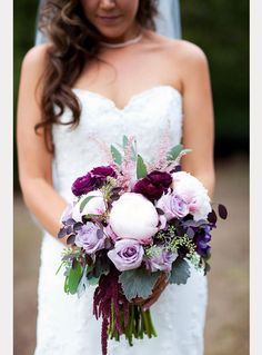 Bridal bouquet with white peonies, purple roses, and soft pink astilbe.