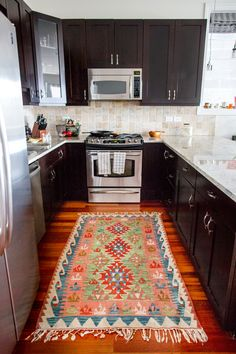Golden Girl Home Tour–Kilim rug in the kitchen (plus, you won't believe the before and after!)