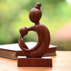 Hand-carved of rich suar wood, a small child rests in their mother's loving arms. Balinese artisan Komang Sri invites you to explore themes of love and family with this impressive sculpture that adds wonderfully to your home decor. Suar wood Wood grain and color can vary slightly Hand-crafted item -- color, size and/or motif may vary slightly Made in Indonesia Dremel Wood Carving, Wood Carving Art, Wood Art, Wood Wood, Easy Clay Sculptures, Sculpture Clay, Family Sculpture, Digital Art Photography, Wood Carving Designs