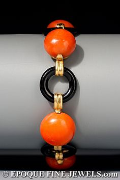 Marzo  An unusual Art Deco onyx and coral bracelet, composed of 5 large coral spheres and 5 onyx links, mounted in 18 karat yellow gold. Circa 1925