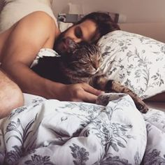 These two are very sleepy, but they won't mind if you wake them up.   36 Seriously Hot Men With Cute Cats That Will Melt You Completely