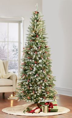 Tip: if you're short on space, use a slim Christmas tree. #holidays HomeDecorators.com