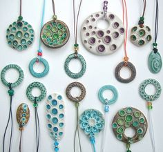 love these ceramic pendants from c-urchin, Lisa Stevens. Could easily be polymer clay too.