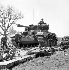 British Comet tanks of the 2nd Fife and Forfar Yeomanry, 11th Armoured Division, crossing the Weser at Petershagen, Germany, 7 April 1945.
