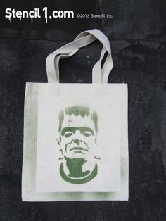 Stenciled Halloween tote bags using Stencil1 Frankenstein stencil and green ink Sprayers available at Stencil1.com