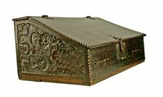 An oak Bible box, a plain front but nicely carved end panels. Two drawers in the interior. 17th Century