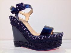 Black patent leather wedge sandal from Christian Louboutin.