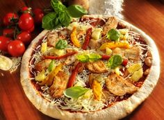 This is a delectable recipe. Starting with a delicious barbecue sauce, our grilled pizza is topped with chunks of tender chicken, sweet pineapple and savory peppers. Serve this pizza at a summer gathering or whenever you want a flavor of Hawaii. The exotic flavors blend nicely, transporting you over the waves to the beautiful beaches of Waikiki.