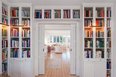 book shelves; above the door shelves with moulding.