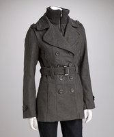 Seasonal trends have their time and place, but sometimes a woman simply craves a classic. This chic peacoat sits long on the frame, protecting the body from the elements from shoulder tomid-thigh.Zippered pockets and a belted waist add extra elements of style that cannot be duplicated.Includes coat and beltMeasurements (size S): 23'' long from high poin...