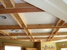 Coffered Ceiling - YouTube Love that it is diagonal instead of straight boxes. That ceiling fan is so unique!