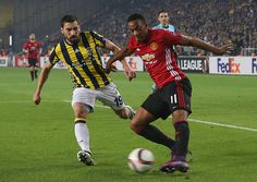 Anthony Martial of Manchester United in action with Sener Ozbayrakli of Fenerbahce during the UEFA Europa League match between Manchester United and...