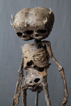 "18"" long mummified demon baby with articulated joints, 3 eyes and 6 horns…"