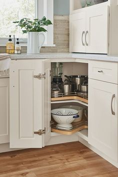 Customize your kitchen cabinets with storage and organization that suits your needs and lifestyle. #diykitchen #kitchenstorage