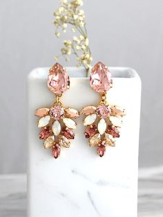 Blush Earrings, Bridal Blush Earrings, Morganite Drop Earrings, Blush Dangle Earrings, Roe Gold Earrings, Bridal Blush Chandelier Earrings  IF YOU WANT THE BEST CHOSE THE ORIGINAL Arrives in our signature Petite Delights by Ilona Rubin® Box. Sent By Registered Insured international mail. Petite delights® design . Petite Delights® is an Official SWAROVSKI® Branding Partner Official Swarovski Elements® Partner Made with real genuine high quality Austrian Swarovski ©Crystal . Our brand is…