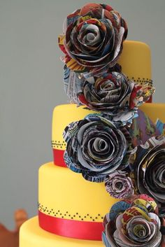 Lapel roses made from comic book pages - not sure why they put them on a cake!