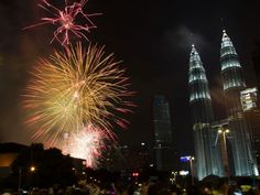 Fireworks explode in front of Malaysia's landmark building, Petronas Twin Towers, during the New Year's Eve celebration in Kuala Lumpur, Malaysia January 1, 2017