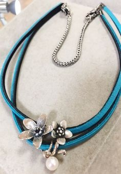 Use a bracelet to make a double stranded leather bracelet into a necklace! Available at Faini Designs Jewelry Studio in Sioux Falls, SD.