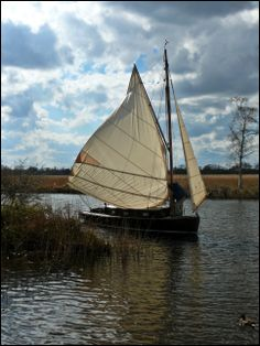 Classic yacht at Howe Hill, Norfolk Broads, England