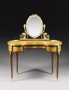 Paul Sormani 1817 - 1887 A Louis XVI style gilt bronze mounted mahogany and satinwood parquetry dressing table, Paris, last quarter 19th century