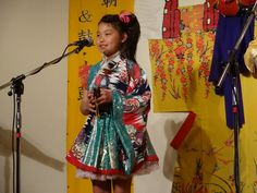 Ruon Yonaha,she is playing sanba( okinawan castanets)