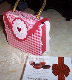 Purse Box.....this is so cute. Great gift for my girls to give to their grandmothers.  Cut the 2 Top Notes out of the rectangle coasters I got from craftersalley.com They are the perfect size; I used Bella Rose Paper and the top closure is Riding Hood Red from the large scallop circle die. I used Gold for the handle. The box inside fits the Russell Stover small candy box or you could make some 3 x 3 gift tags, etc. TFL