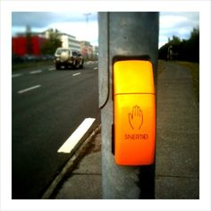 Translate this - SNERTÐ. Touch? Push? Spotted lots of different pedestrian crossing buttons in Reykjavík.