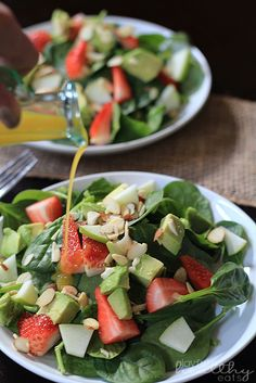 A healthy summer salad that comes together in 15 minutes! Avocado Strawberry Spinach Salad | www.joyfulhealthyeats.com #glutenfree #paleo #30minutemeal