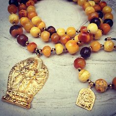 Black Dakini editorial amber necklace with Avalokiteshvara golden amulet
