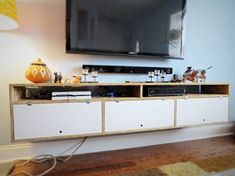 DIY wall mounted TV console and entertainment center. A great way to open up floor space and reduce clutter.