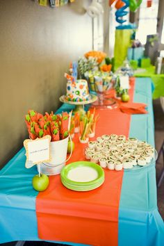 Orange, blue and green party. Plastic table cloth with another for a runner