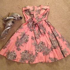 New Beautiful floral dress This is a strapless dress. Button opening on the front. It Is forever 21  size small. Never worn. Dresses Mini
