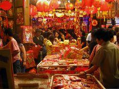 A scene in a street market in Chinatown, Singapore, during the Chinese New Year holidays. Description from liberallifestyles.com. I searched for this on bing.com/images