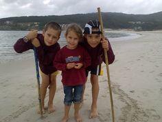 Os tres na praia