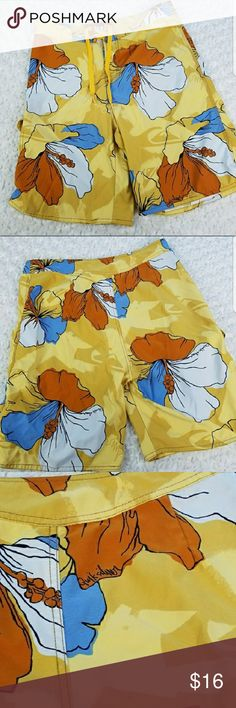 Quiksilver Hibiscus Board Shorts Swim Trunks Mens swim trunks. Yellow, blue, orange and white. Hibiscus print. Very small spot as shown in last picture. Quiksilver Swim Board Shorts