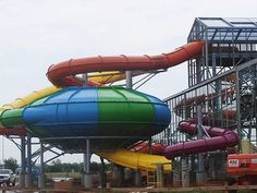 Inside-out water slides that go outside the Water Zoo are shown. The 28,000-square-foot attraction has glass walls and a retractable roof that can be opened on warm days.