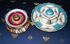 Two inkwells. One has a picture of Napoleon and the other of Josephine. Judith Walker's Collection